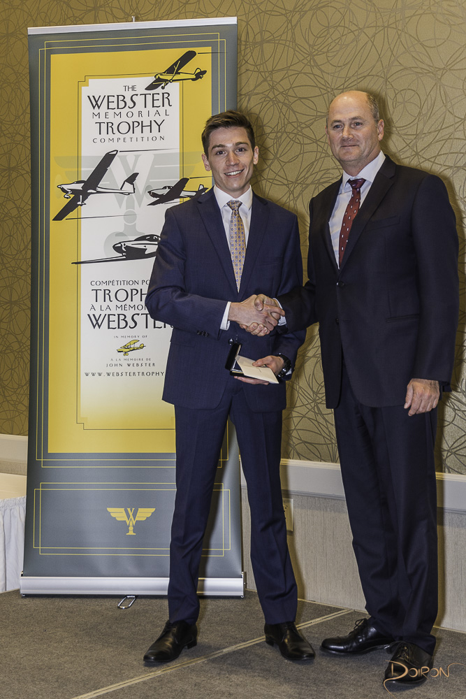 2017 winner, Liam Cohen (left) is receiving the Webster Medallion from Chris Clarke, Director of Flight Operations at Air Canada Rouge.
